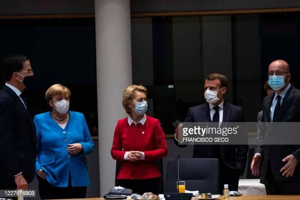 Germany's Chancellor Angela Merkel stands next to Netherlands' Prime Minister Mark Rutte President of the European Commission Ursula von der Leyen...