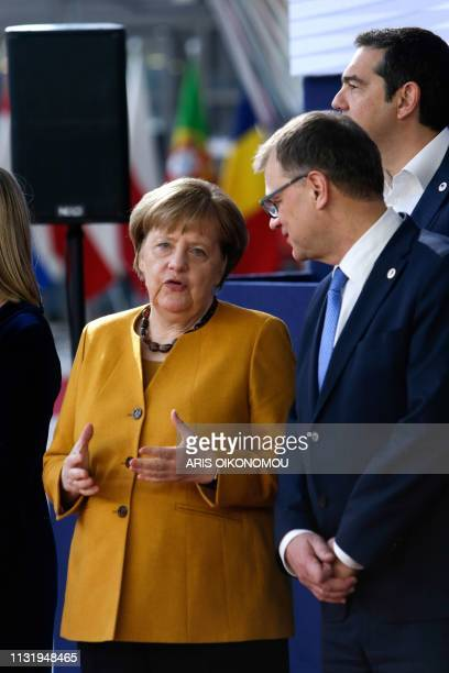 Germany's Chancellor Angela Merkel talks with Sweden's Prime Minister Stefan Lofven during a family photo on March 22 2019 in Brussels at the end of...