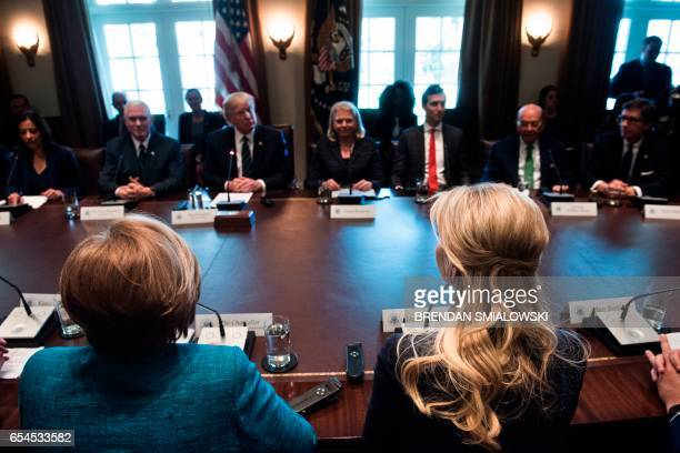 Germany's Chancellor Angela Merkel US President Donald Trump Ivanka Trump and others wait for a meeting with business leaders in the Cabinet Room of...