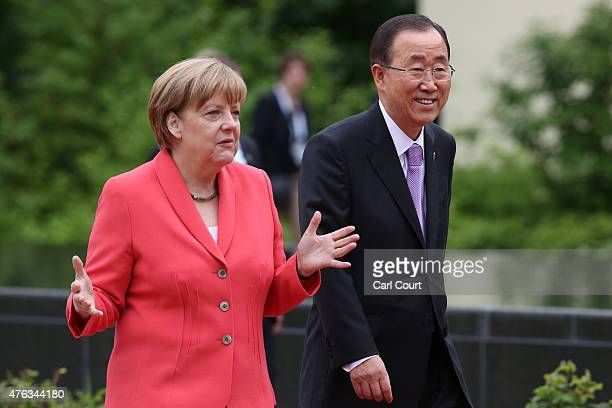 Germany's Chancellor Angela Merkel walks with United Nations SecretaryGeneral Ban KiMoon to a working session with outreach guests at the summit of...