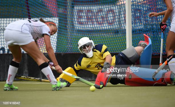 Germany's Charlotte Stapenhorst and Scotland's goalkeeper Amy Gibson compete for the ball during the women's international hockey match in Hamburg...