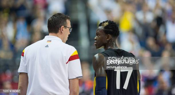 Germany's Chris Fleming talks to his player Dennis Schroeder the FIBA EuroBasket 2015 Group B match Italy vs Germany in Berlin Germany 09 September...
