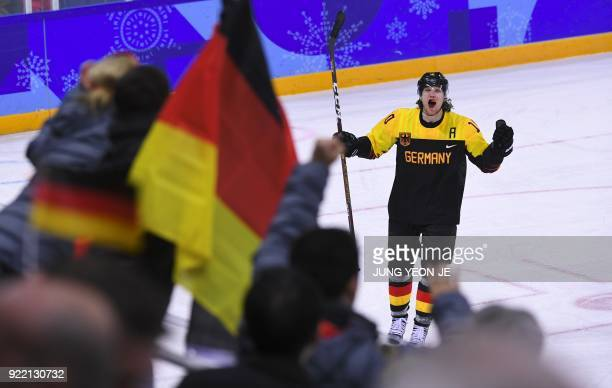 TOPSHOT Germany's Christian Ehrhoff celebrates the victory after the men's quarterfinal ice hockey match between Sweden and Germany during the...