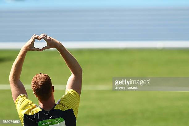 TOPSHOT Germany's Christoph Harting celebrates after he won the Men's Discus Throw Final during the athletics event at the Rio 2016 Olympic Games at...