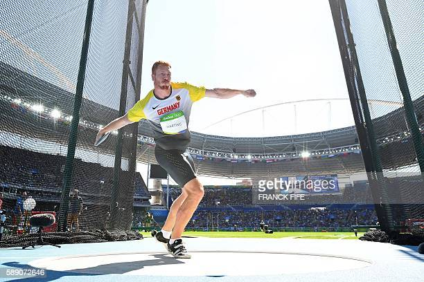 Germany's Christoph Harting competes in the Men's Discus Throw Final during the athletics event at the Rio 2016 Olympic Games at the Olympic Stadium...