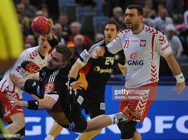 Germany's Christoph Theuerkauf shoots past Poland's Bartosz Jurecki during the men's EHF Euro 2012 Handball Championship match Poland vs Germany on...