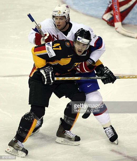 Germany's Christoph Ullmann and Norway's Morten Ask battle foe position during the preliminary round of the 2008 IIHF World Hockey Championships at...