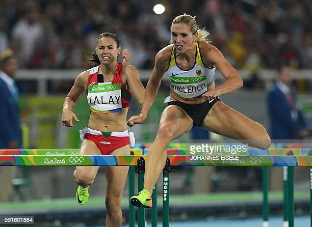 Germany's Cindy Roleder and Belarus' Alina Talay compete in the Women's 100m Hurdles Semifinal during the athletics event at the Rio 2016 Olympic...