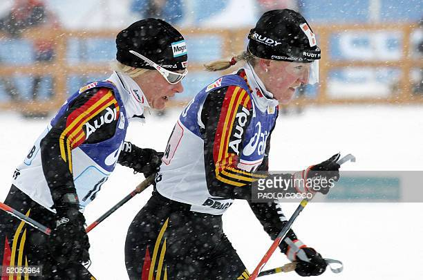 Germany's Claudia Kuenzel pushes her teammate Viola Bauer during a Women's World Cup 6 x 1,1km team sprint cross country race in the Italian northern...