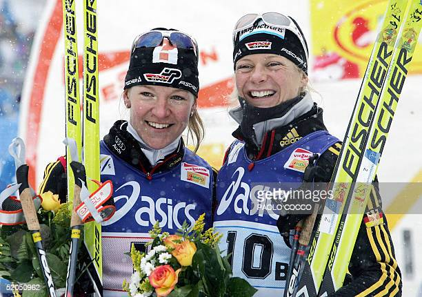 Germany's Claudia Kuenzel smiles on the finish line with teammate Viola Bauer after winning a Women's World Cup 6 x 1,1km team sprint cross country...