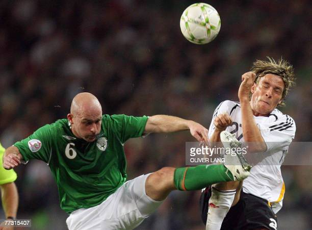 Germany's Clemens Fritz and Ireland's Lee Carsley vies for the ball during the Republic of Ireland vs Germany Euro 2008 group D qualifying match at...
