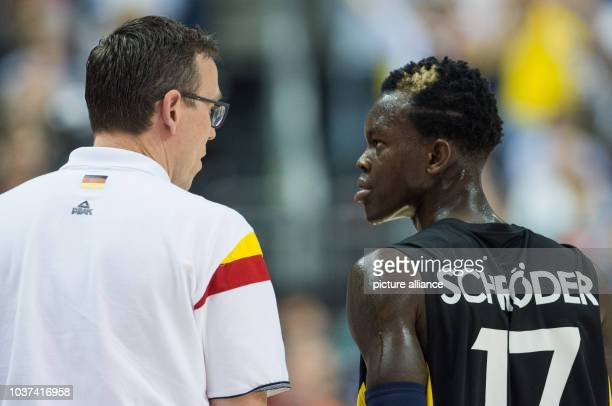 Germany's coach Chris Fleming talks to his player Dennis Schroeder the FIBA EuroBasket 2015 Group B match Italy vs Germany in Berlin Germany 09...