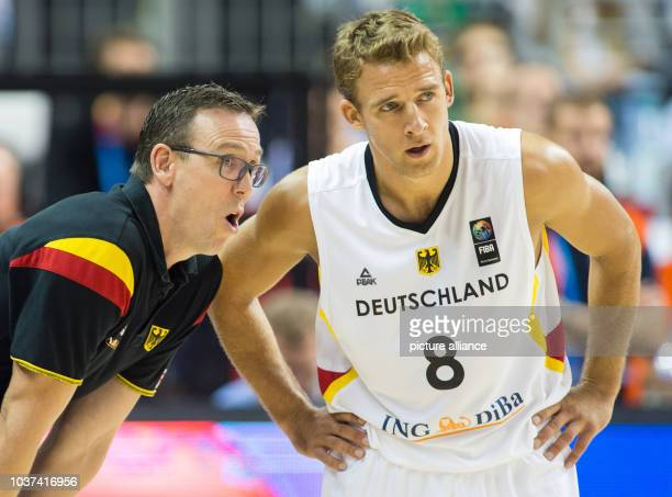 Germany's coach Chris Fleming talks to his player Heiko Schaffartzik during the FIBA EuroBasket 2015 Group B match between Germany and Turkey at the...