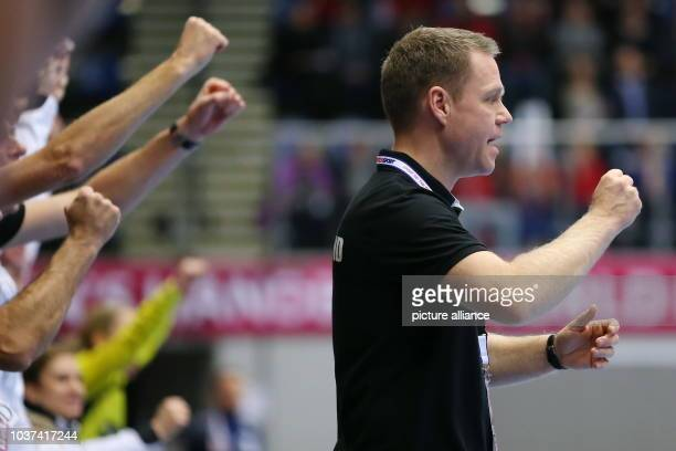 Germany's coach Jakob Vestergaard reacts during the World Women's Handball Championship match between Germany and Norway in Frederikshavn, Denmark,...