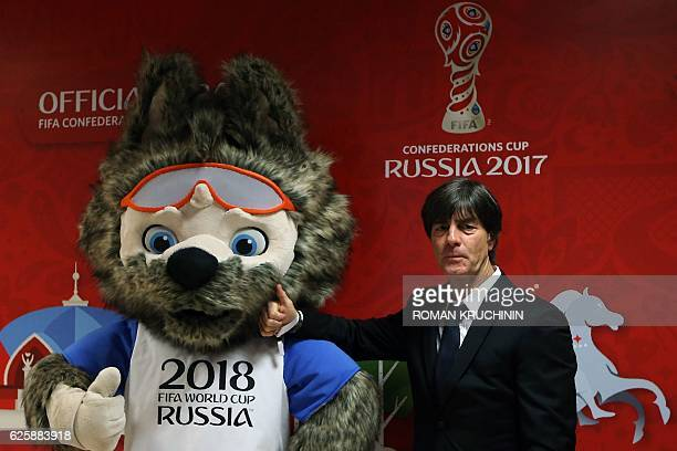 Germany's coach Joachim Loew accompanied by Zabivaka the mascot for the 2018 World Cup arrives to attend the draw for the 2017 FIFA Confederations...