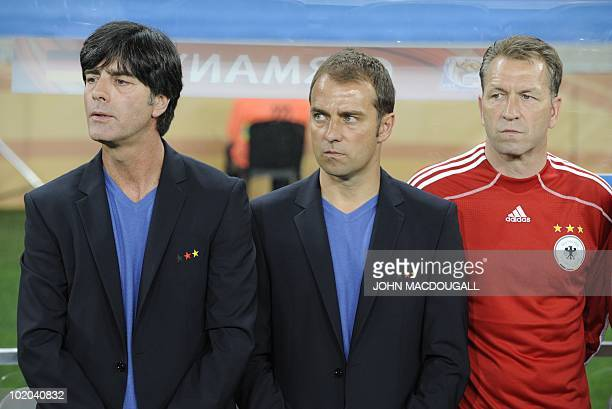 Germany's coach Joachim Loew assistant coach Hansi Flick and goalkeeper coach Andreas Koepke attend Germany's 2010 World Cup group D first round...