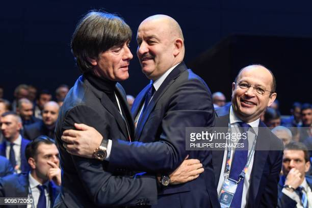 Germany's coach Joachim Loew embraces Russia's coach Stanislas Cherchesov prior to the UEFA Nations League draw at the heaquarters of the European...