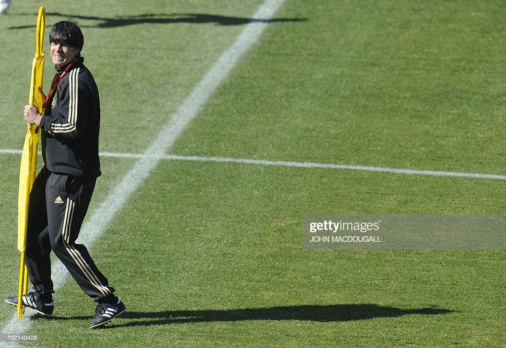Germany's coach Joachim Loew places markers during a training session at the Super stadium in Atteridgeville near Pretoria June 16, 2010.
