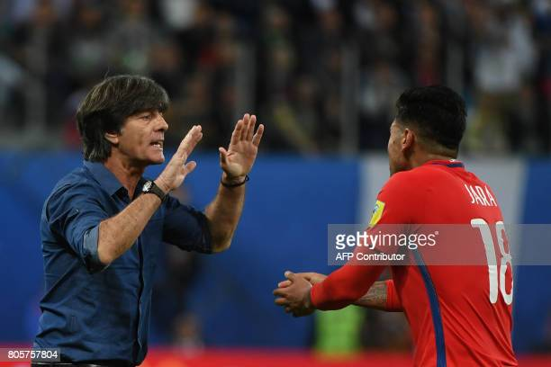 Germany's coach Joachim Loew salutes Chile's defender Gonzalo Jara after Germany beat Chile 10 to win the 2017 Confederations Cup final football...