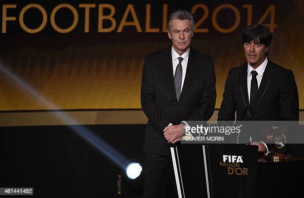 Germany's coach Joachim Loew speaks next to Switzerland's German coach Ottmar Hitzfeld after receiving the 2014 FIFA World Coach of the Year for...