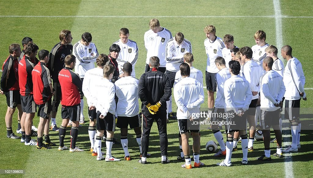 Germany's coach Joachim Loew speaks to his players at the start of a training session at the Super stadium in Atteridgeville near Pretoria June 16, 2010. The 2010 World Cup hosted by South Africa continues through July 11.