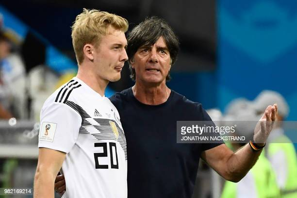 Germany's coach Joachim Loew speaks with Germany's forward Julian Brandt during the Russia 2018 World Cup Group F football match between Germany and...