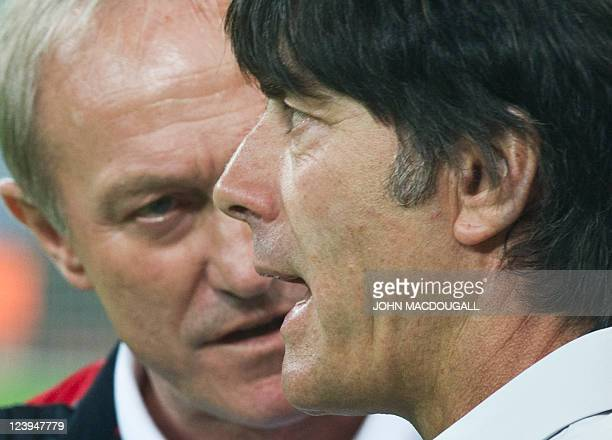 Germany's coach Joachim Loew speaks with Poland's coach Franciszek Smuda during the warm up session prior to the International friendly football...