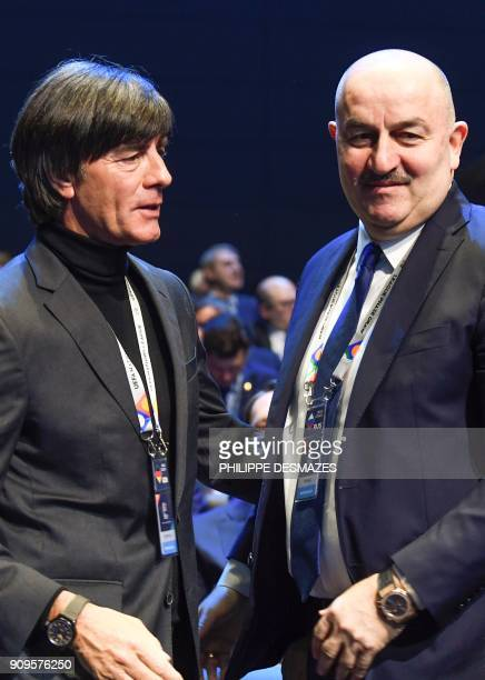 Germany's coach Joachim Loew speaks with Russia's coach Stanislas Cherchesov as they arrive to attend the UEFA Nations League draw at the...