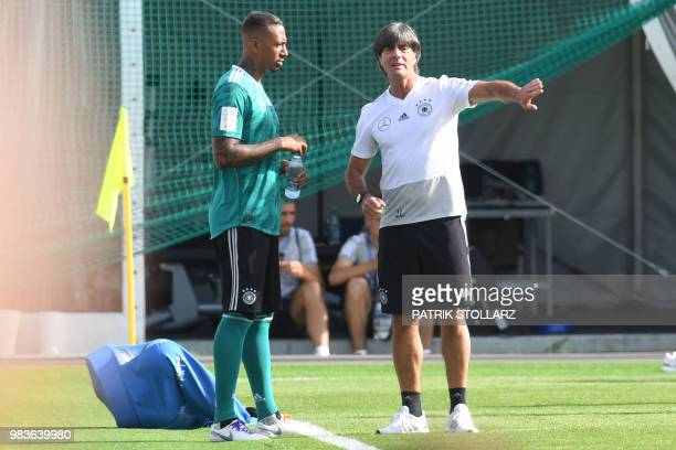Germany's coach Joachim Loew talks to defender Jerome Boateng during a training session in Vatutinki on June 25 during the Russia 2018 World Cup...