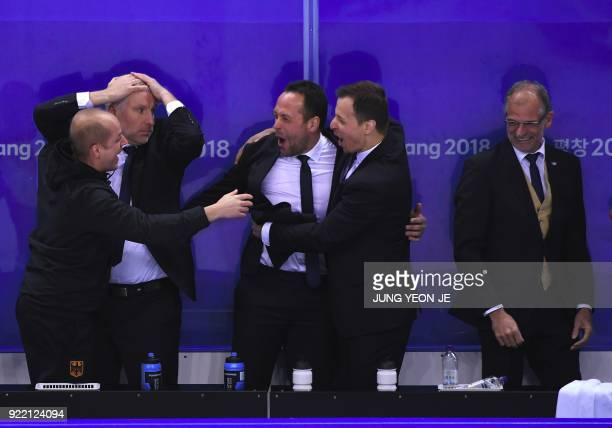 Germany's coaches celebrate their victory after the men's quarterfinal ice hockey match between Sweden and Germany during the Pyeongchang 2018 Winter...