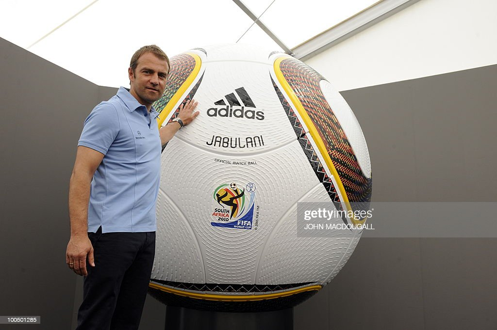 Germany's co-trainer Hansi Flick poses is front of a giant football during a press conference in Appiano, near the north Italian city of Bolzano May 25, 2010. The German football team is currently taking part in a 12-day training camp in Appiano to prepare for the upcoming FIFA Football World Cup in South Africa.