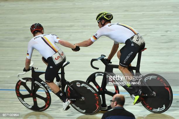 Germany's cycling team relay during the men's madison final during the UCI Track Cycling World Championships in Apeldoorn on March 4 2018 / AFP PHOTO...