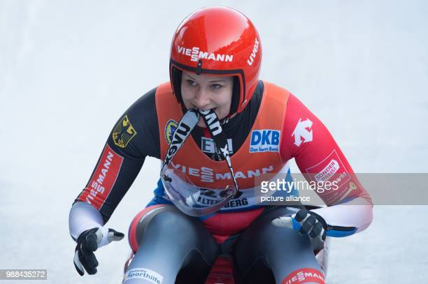 Germany's Dajana Eitberger taking off her helmet's visor at the finish line during the women's singles event at the Luge World Cup in Altenberg,...