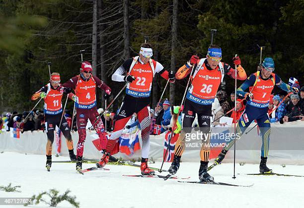 Germany's Daniel Boehm Latvia's Andrejs Rastorgujevs Austria's Julian Eberhard Germany's Erik Lesser and Sweden's Fredrik Lindstroem compete in the...