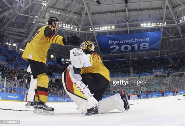 Germany's Danny aus den Birken and Germany's Timo Pielmeier celebrate after winning the men's semifinal ice hockey match between Canada and Germany...