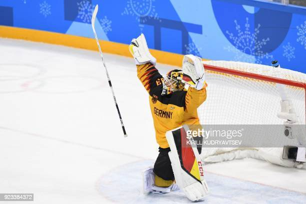 Germany's Danny aus den Birken celebrates winning the men's semifinal ice hockey match between Canada and Germany during the Pyeongchang 2018 Winter...