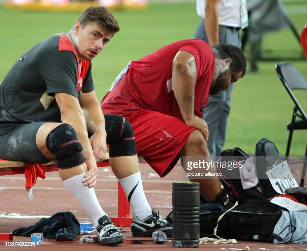 Germany's David Storl and Reese Hoffa of the USA prepare for the Men's Shot Put final at the 15th International Association of Athletics Federations...