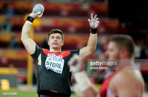 Germany's David Storl prepares next to Joe Kovacs of the USA for the Men's Shot Put final at the 15th International Association of Athletics...