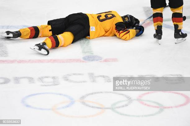 Germany's David Wolf lies on the ice after being hit in the men's semifinal ice hockey match between Canada and Germany during the Pyeongchang 2018...