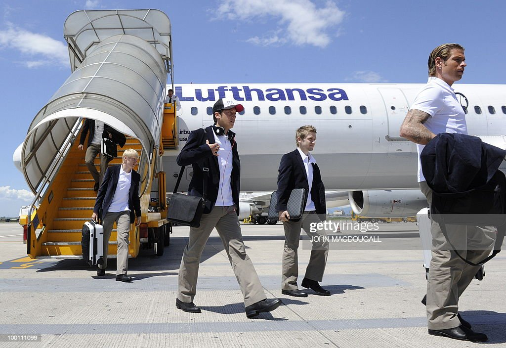 Germany's defender Andreas Beck, Germany's midfielder Mesut Oezil, Germany's midfielder Marko Marin, and goalkeeper Time Wiese get off the plane in Verona May 21, 2010, as the German team arrives for a 12-day long training camp near Bolzano to prepare for the upcoming FIFA Football World Cup in South Africa.