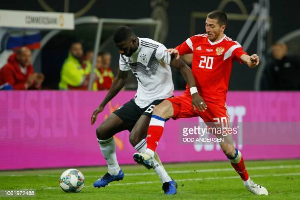 Germany's defender Antonio Ruediger and Russia's midfielder Alexey Ionov vie for the ball during the international friendly football match Germany v...