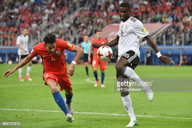 Germany's defender Antonio Ruediger challenges Chile's defender Mauricio Isla during the 2017 Confederations Cup final football match between Chile...