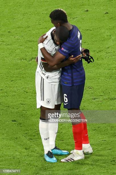 Germany's defender Antonio Ruediger is greeted by France's midfielder Paul Pogba at the end of the UEFA EURO 2020 Group F football match between...