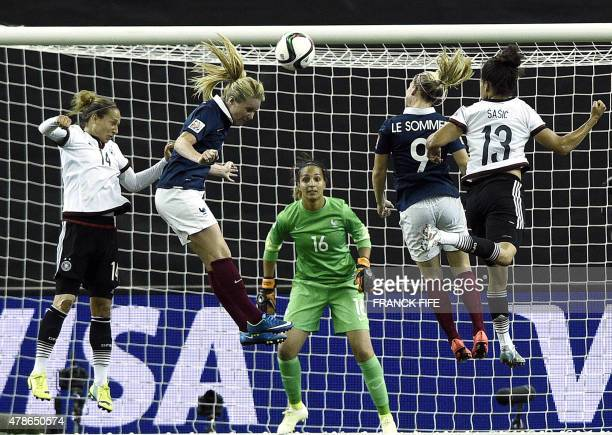 Germany's defender Babett Peter , France's midfielder Amandine Henry , France's forward Eugenie Le Sommer and Germany's forward Celia Sasic jump for...