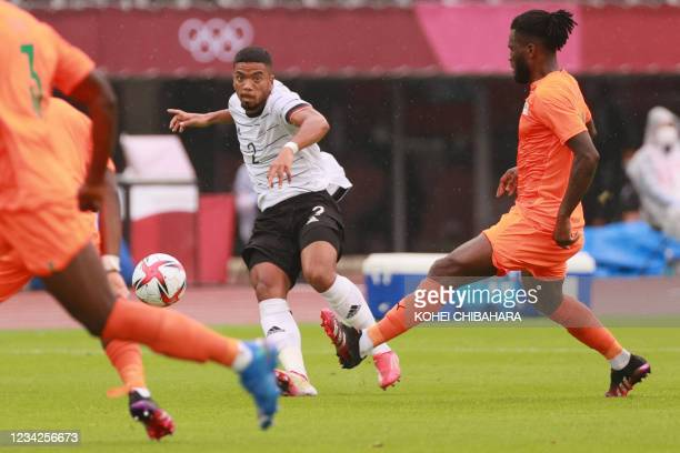 Germany's defender Benjamin Henrichs fights for the ball during the Tokyo 2020 Olympic Games men's group D first round football match between Germany...