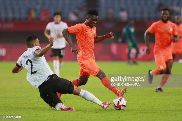 Germany's defender Benjamin Henrichs tackles Ivory Coast's forward Youssouf Dao during the Tokyo 2020 Olympic Games men's group D first round...