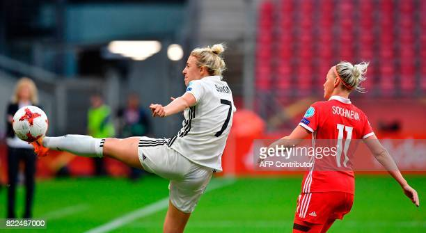 Germany's defender Carolin Simon vies with Russia's midfielder Ekaterina Sochneva during the UEFA Women's Euro 2017 football match between Russia and...