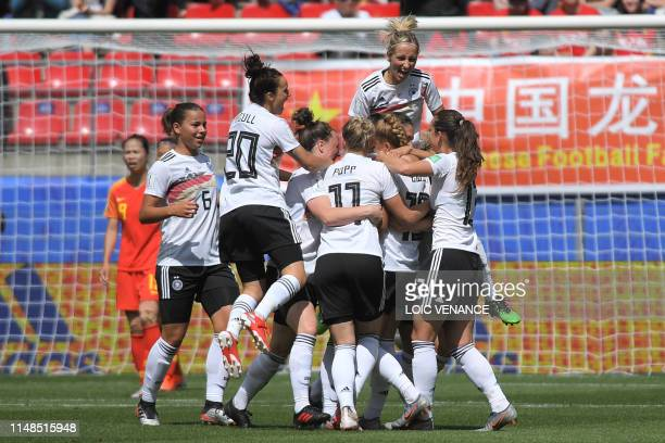 TOPSHOT Germany's defender Giulia Gwinn celebrates with teammates after scoring a goal during the France 2019 Women's World Cup Group B football...
