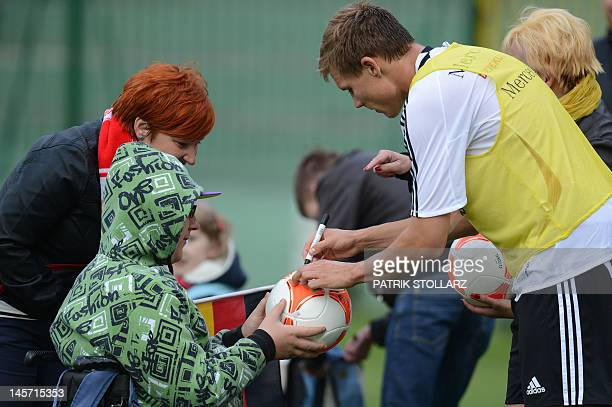 Germany´s defender Holger Badstuber poses with fans after a training session at the Gdansk Municipal stadium in Gdansk on June 4 ahead of the Euro...