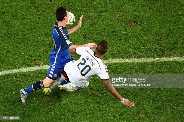 Germany's defender Jerome Boateng and Argentina's forward and captain Lionel Messi compete for the ball during the final football match between...